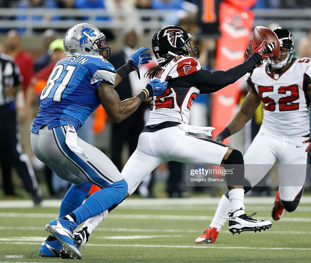 Asante Samuel #22 of the Atlanta Falcons makes a fourth quarter interception in front of Calvin Johnson #81 of the Detroit Lions at Ford Field on December 22, 2012 in Detroit, Michigan. Atlanta won the game 31-18.