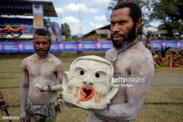 Asaro mudmen presenting mask at  the 61st Goroka Cultural Show in Papua New Guinea