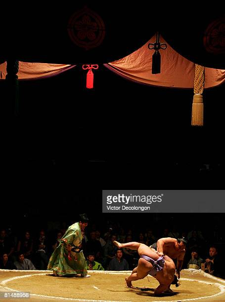 Asashoryu throws down Goeido in the first match of the third round during the 2008 Grand Sumo Tournament at the Los Angeles Memorial Sports Arena on...