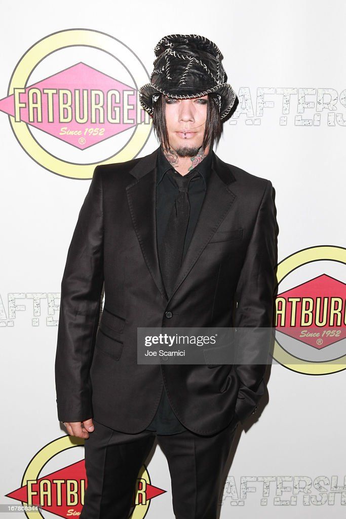 DJ Asba arrives at the 'AFTERSHOCK' premiere presented by Dimension Films and RADiUS-TWC in partnership with Fatburger at on May 1, 2013 in Los Angeles, California.