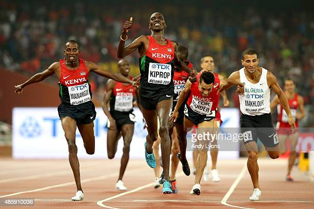Asbel Kiprop of Kenya crosses the finish line to win gold in the Men's 1500 metres final ahead of Elijah Motonei Manangoi of Kenya and Abdalaati...