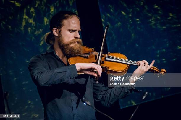 Asbjorn Noorggard of Danish String Quartett performs live on stage during Yellow Lounge x Reeperbahn Festival organized by recording label Deutsche...