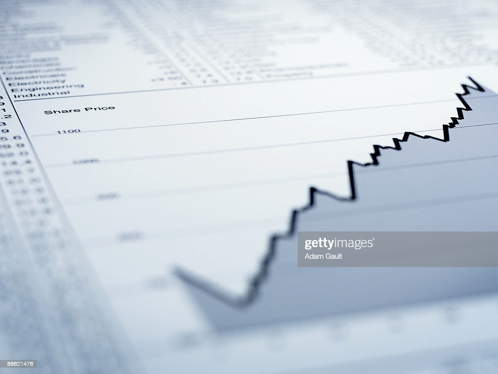 Ascending line graph and list of share prices : Stock Photo