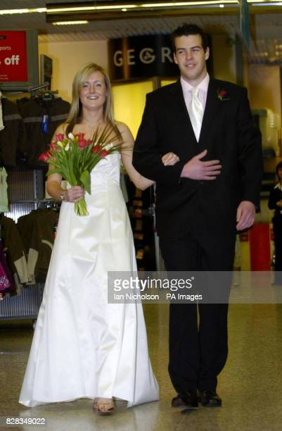 Asda bridal wear is launched by models at the company's Watford store Tuesday February 14 2006 Colette wearing a onepiece gown priced at 60 is...