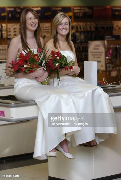 Asda bridal wear is launched by models at the company's Watford store Tuesday February 14 2006 Clare wears a twopiece outfit on sale for 65 and...