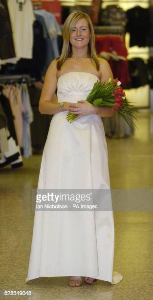 Asda bridal wear is launched by models at the company's Watford store Tuesday February 14 2006 Colette wears a onepiece gown priced at 60 Watch for...