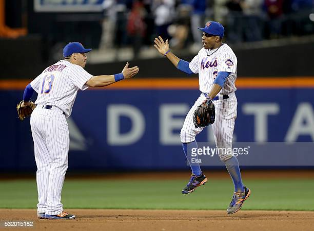 Asdrubal Cabrera and Curtis Granderson of the New York Mets celebrate the 20 win over the Washington Nationals at Citi Field on May 17 2016 in the...