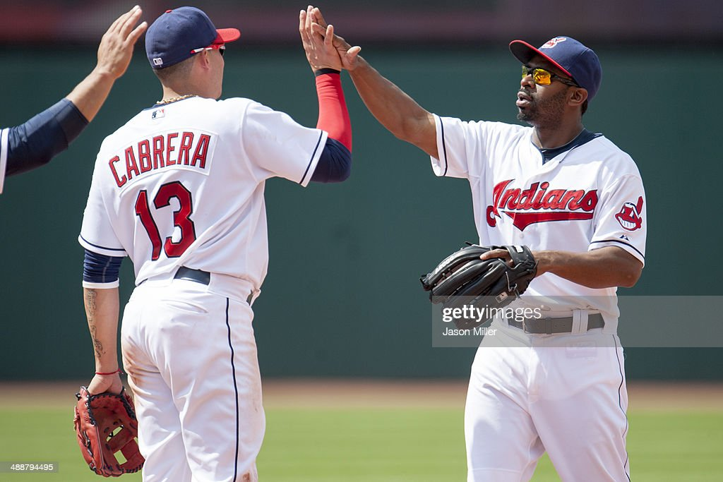 <a gi-track='captionPersonalityLinkClicked' href=/galleries/search?phrase=Asdrubal+Cabrera&family=editorial&specificpeople=834042 ng-click='$event.stopPropagation()'>Asdrubal Cabrera</a> #13 and <a gi-track='captionPersonalityLinkClicked' href=/galleries/search?phrase=Michael+Bourn&family=editorial&specificpeople=835742 ng-click='$event.stopPropagation()'>Michael Bourn</a> #24 of the Cleveland Indians celebrate after the Indians defeated the Minnesota Twins at Progressive Field on May 8, 2014 in Cleveland, Ohio. The Indians defeated the Twins 9-4.