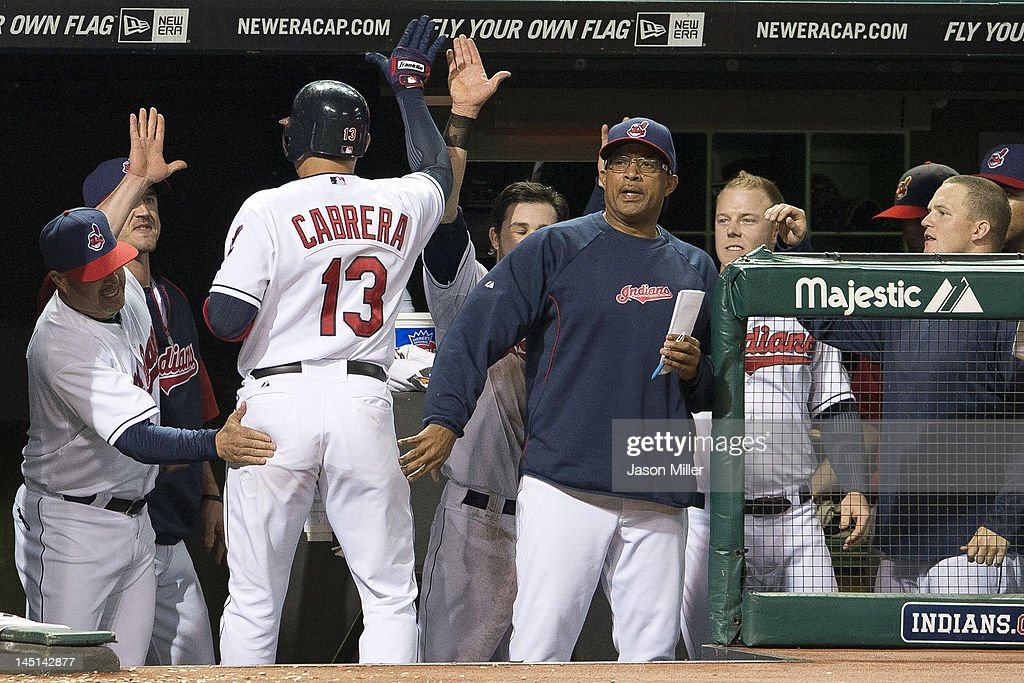 <a gi-track='captionPersonalityLinkClicked' href=/galleries/search?phrase=Asdrubal+Cabrera&family=editorial&specificpeople=834042 ng-click='$event.stopPropagation()'>Asdrubal Cabrera</a> #13 celebrates in the dugout after scoring on a sacrifice fly hit by Carlos Santana #41 of the Cleveland Indians during the eighth inning against the Detroit Tigers at Progressive Field on May 23, 2012 in Cleveland, Ohio.