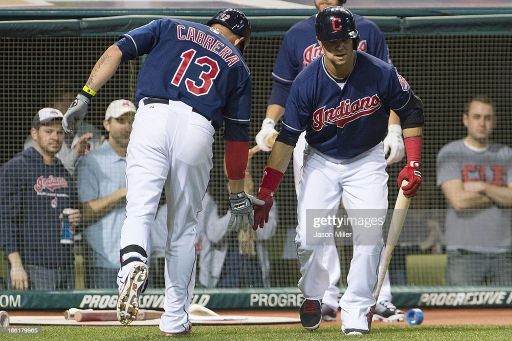 <a gi-track='captionPersonalityLinkClicked' href=/galleries/search?phrase=Asdrubal+Cabrera&family=editorial&specificpeople=834042 ng-click='$event.stopPropagation()'>Asdrubal Cabrera</a> #13 celebrates with <a gi-track='captionPersonalityLinkClicked' href=/galleries/search?phrase=Nick+Swisher&family=editorial&specificpeople=206417 ng-click='$event.stopPropagation()'>Nick Swisher</a> #33 of the Cleveland Indians after Cabrera hit a solo home run in the sixth inning against the New York Yankees at Progressive Field on April 9, 2013 in Cleveland, Ohio.