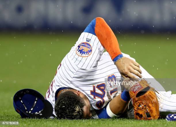 Asdrubal Cabrera grabs his thumb after fielding a hit by Marcell Ozuna of the Miami Marlins in the third inning on May 6 2017 at Citi Field in the...