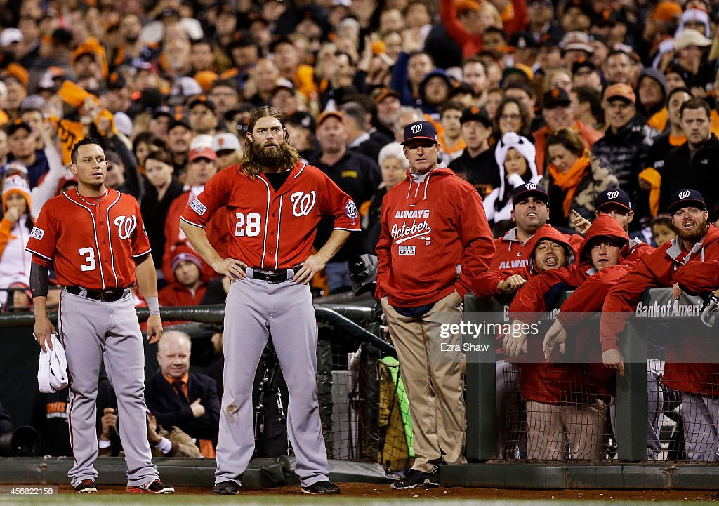 Asdrubal Cabrera #3, Jayson Werth #28 and manager Matt Williams #9 of the Washington Nationals look on in the ninth inning of their 3 to 1 losss to the San Francisco Giants in Game Four of the National League Division Series at AT&T Park on October 7, 2014 in San Francisco, California.