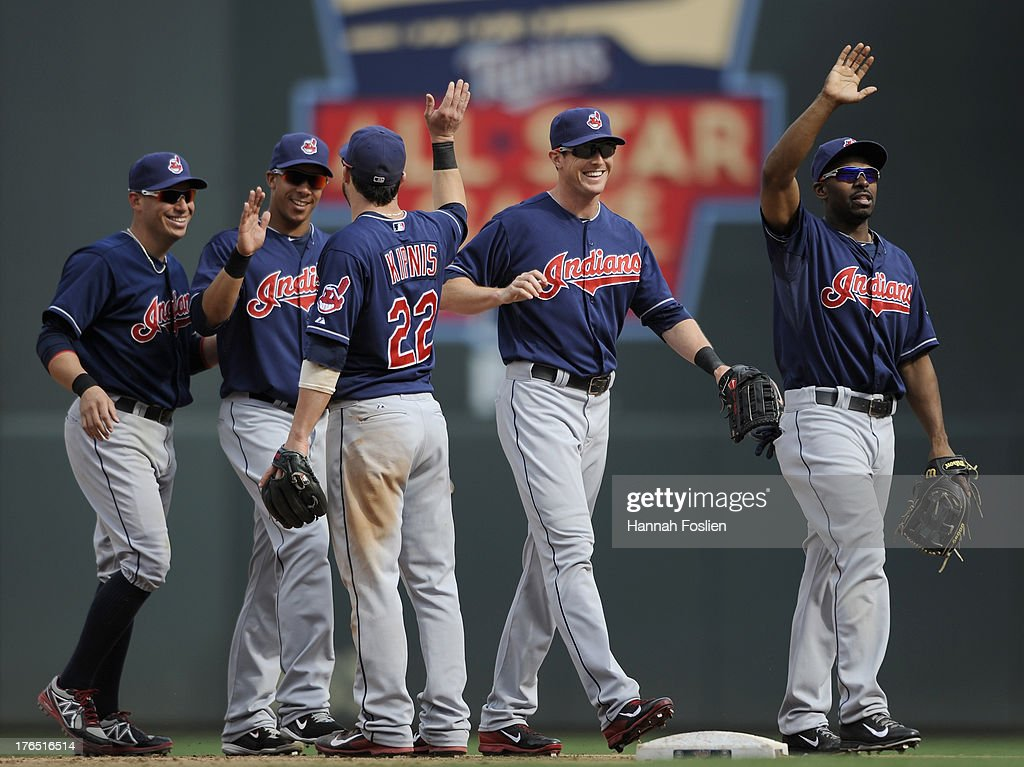 <a gi-track='captionPersonalityLinkClicked' href=/galleries/search?phrase=Asdrubal+Cabrera&family=editorial&specificpeople=834042 ng-click='$event.stopPropagation()'>Asdrubal Cabrera</a> #13, Michael Brantley #23, <a gi-track='captionPersonalityLinkClicked' href=/galleries/search?phrase=Jason+Kipnis&family=editorial&specificpeople=5330784 ng-click='$event.stopPropagation()'>Jason Kipnis</a> #22, <a gi-track='captionPersonalityLinkClicked' href=/galleries/search?phrase=Drew+Stubbs+-+Baseball+Player&family=editorial&specificpeople=4498334 ng-click='$event.stopPropagation()'>Drew Stubbs</a> #11 and <a gi-track='captionPersonalityLinkClicked' href=/galleries/search?phrase=Michael+Bourn&family=editorial&specificpeople=835742 ng-click='$event.stopPropagation()'>Michael Bourn</a> #24 of the Cleveland Indians celebrate a win of the game against the Minnesota Twins on August 14, 2013 at Target Field in Minneapolis, Minnesota. The Indians defeated the Twins 9-8 in twelve innings.