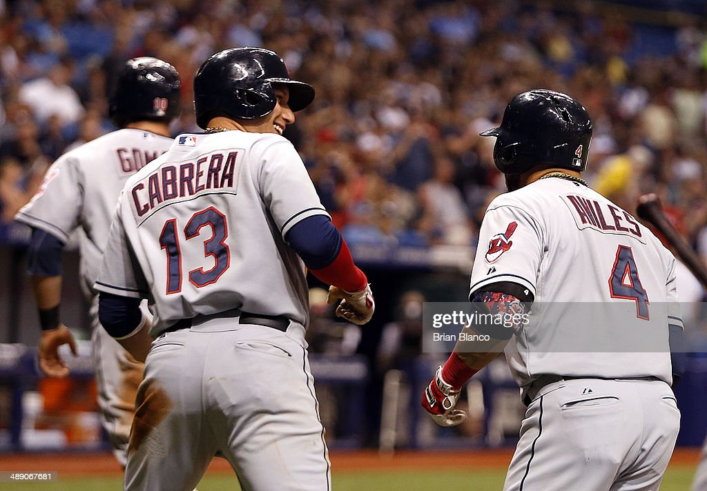 <a gi-track='captionPersonalityLinkClicked' href=/galleries/search?phrase=Asdrubal+Cabrera&family=editorial&specificpeople=834042 ng-click='$event.stopPropagation()'>Asdrubal Cabrera</a> #13 of the Cleveland Indians and <a gi-track='captionPersonalityLinkClicked' href=/galleries/search?phrase=Mike+Aviles&family=editorial&specificpeople=4944765 ng-click='$event.stopPropagation()'>Mike Aviles</a> #4 of the Cleveland Indians celebrate after scoring off of Aviles' three-run home run during the seventh inning of a game against the Tampa Bay Rays on May 9, 2014 at Tropicana Field in St. Petersburg, Florida.