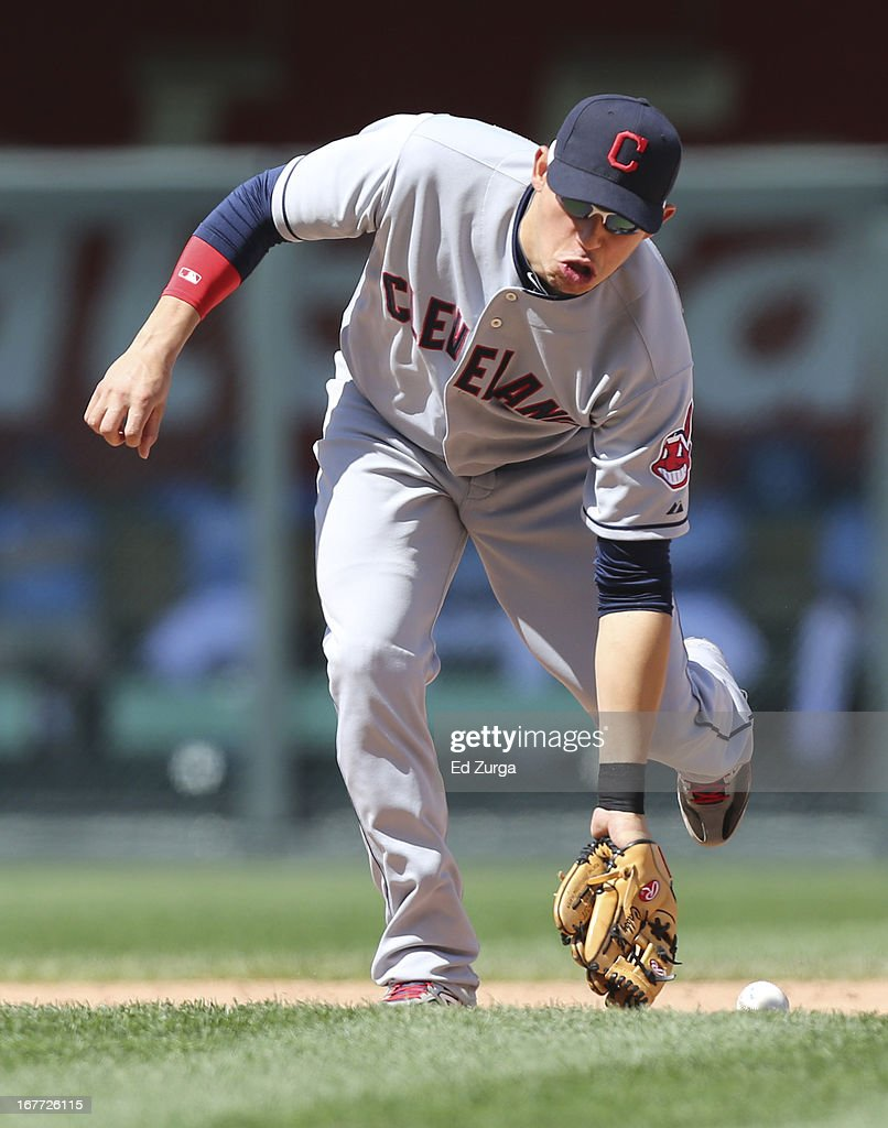 <a gi-track='captionPersonalityLinkClicked' href=/galleries/search?phrase=Asdrubal+Cabrera&family=editorial&specificpeople=834042 ng-click='$event.stopPropagation()'>Asdrubal Cabrera</a> #13 of the Cleveland Indians can't field a ball hit by Chris Getz of the Kansas City Royals in the seventh inning during game one of a doubleheader at Kauffman Stadium on April 28, 2013 in Kansas City, Missouri.