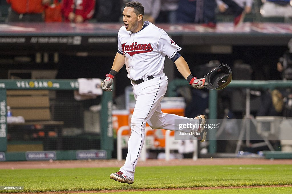 <a gi-track='captionPersonalityLinkClicked' href=/galleries/search?phrase=Asdrubal+Cabrera&family=editorial&specificpeople=834042 ng-click='$event.stopPropagation()'>Asdrubal Cabrera</a> #13 of the Cleveland Indians celebrates after hitting a walk-off there run home run during the twelfth inning against the Boston Red Sox at Progressive Field on June 5, 2014 in Cleveland, Ohio. The Indians defeated the Red Sox 7-4 in 12th inning.