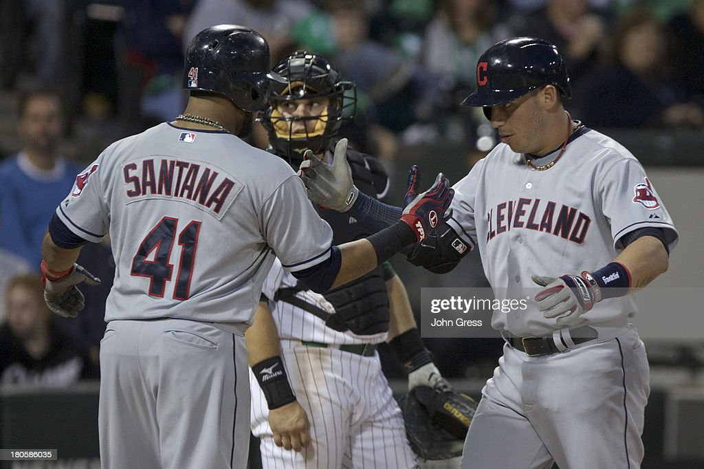 <a gi-track='captionPersonalityLinkClicked' href=/galleries/search?phrase=Asdrubal+Cabrera&family=editorial&specificpeople=834042 ng-click='$event.stopPropagation()'>Asdrubal Cabrera</a> #13 of the Cleveland Indians celebrates with teammate <a gi-track='captionPersonalityLinkClicked' href=/galleries/search?phrase=Carlos+Santana+-+Baseball+Player&family=editorial&specificpeople=11497843 ng-click='$event.stopPropagation()'>Carlos Santana</a> #41 after hitting a two-run home run against the Chicago White Sox during the fourth inning of their MLB game at U.S. Cellular Field on September 14, 2013 in Chicago, Illinois.
