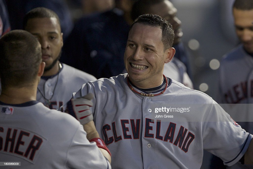 <a gi-track='captionPersonalityLinkClicked' href=/galleries/search?phrase=Asdrubal+Cabrera&family=editorial&specificpeople=834042 ng-click='$event.stopPropagation()'>Asdrubal Cabrera</a> #13 of the Cleveland Indians celebrates with teammate <a gi-track='captionPersonalityLinkClicked' href=/galleries/search?phrase=Nick+Swisher&family=editorial&specificpeople=206417 ng-click='$event.stopPropagation()'>Nick Swisher</a> #33 after hitting a two-run home run against the Chicago White Sox during in the fourth inning of their MLB game at U.S. Cellular Field on September 14, 2013 in Chicago, Illinois.