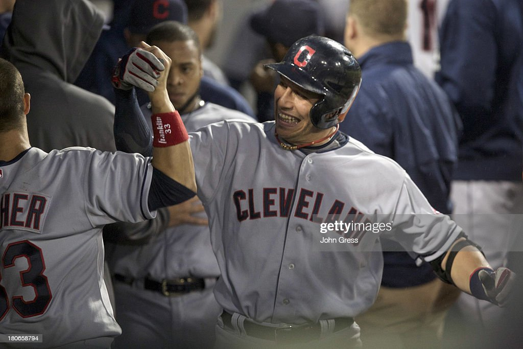 <a gi-track='captionPersonalityLinkClicked' href=/galleries/search?phrase=Asdrubal+Cabrera&family=editorial&specificpeople=834042 ng-click='$event.stopPropagation()'>Asdrubal Cabrera</a> #13 of the Cleveland Indians celebrates with teammate <a gi-track='captionPersonalityLinkClicked' href=/galleries/search?phrase=Nick+Swisher&family=editorial&specificpeople=206417 ng-click='$event.stopPropagation()'>Nick Swisher</a> #33 hitting a three-run home run off of the Chicago White Sox during in the sixth inning of their MLB game at U.S. Cellular Field on September 15, 2013 in Chicago, Illinois.