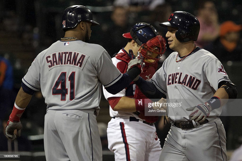 <a gi-track='captionPersonalityLinkClicked' href=/galleries/search?phrase=Asdrubal+Cabrera&family=editorial&specificpeople=834042 ng-click='$event.stopPropagation()'>Asdrubal Cabrera</a> #13 of the Cleveland Indians celebrates with teammate <a gi-track='captionPersonalityLinkClicked' href=/galleries/search?phrase=Carlos+Santana+-+Baseball+Player&family=editorial&specificpeople=11497843 ng-click='$event.stopPropagation()'>Carlos Santana</a> #41 after hitting a three-run home run as Josh Phegley #36 of the Chicago White Sox looks away during in the sixth inning of their MLB game at U.S. Cellular Field on September 15, 2013 in Chicago, Illinois.