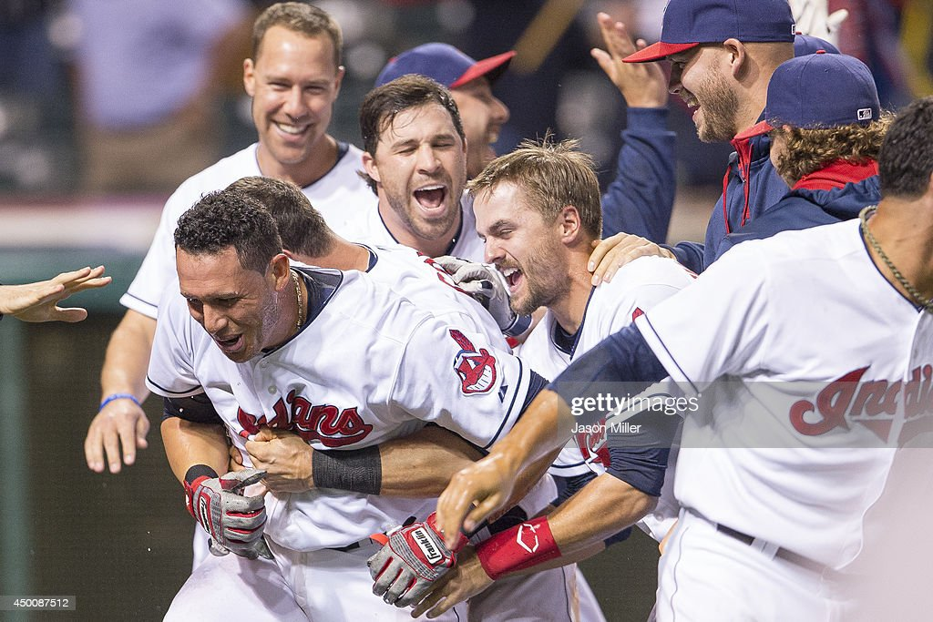 <a gi-track='captionPersonalityLinkClicked' href=/galleries/search?phrase=Asdrubal+Cabrera&family=editorial&specificpeople=834042 ng-click='$event.stopPropagation()'>Asdrubal Cabrera</a> #13 of the Cleveland Indians celebrates with teammates after hitting a walk-off there run home run during the twelfth inning against the Boston Red Sox at Progressive Field on June 5, 2014 in Cleveland, Ohio. The Indians defeated the Red Sox 7-4 in 12th inning.