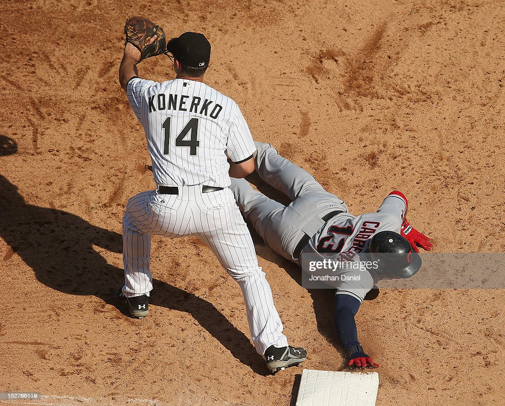 <a gi-track='captionPersonalityLinkClicked' href=/galleries/search?phrase=Asdrubal+Cabrera&family=editorial&specificpeople=834042 ng-click='$event.stopPropagation()'>Asdrubal Cabrera</a> #13 of the Cleveland Indians dives back to 1st base as Paul Konerko #14 of the Chicago White Sox awaits the throw at U.S. Cellular Field on September 25, 2012 in Chicago, Illinois. The Indians defeated the White Sox 4-3.