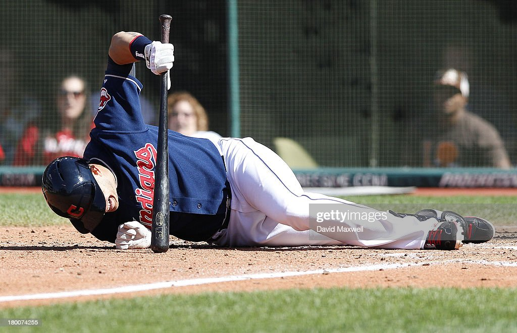 <a gi-track='captionPersonalityLinkClicked' href=/galleries/search?phrase=Asdrubal+Cabrera&family=editorial&specificpeople=834042 ng-click='$event.stopPropagation()'>Asdrubal Cabrera</a> #13 of the Cleveland Indians falls to the ground after being hit by a pitch with the bases loaded against the New York Mets during the sixth inning of their game on September 8, 2013 at Progressive Field in Cleveland, Ohio. The Mets defeated the Indians 2-1.