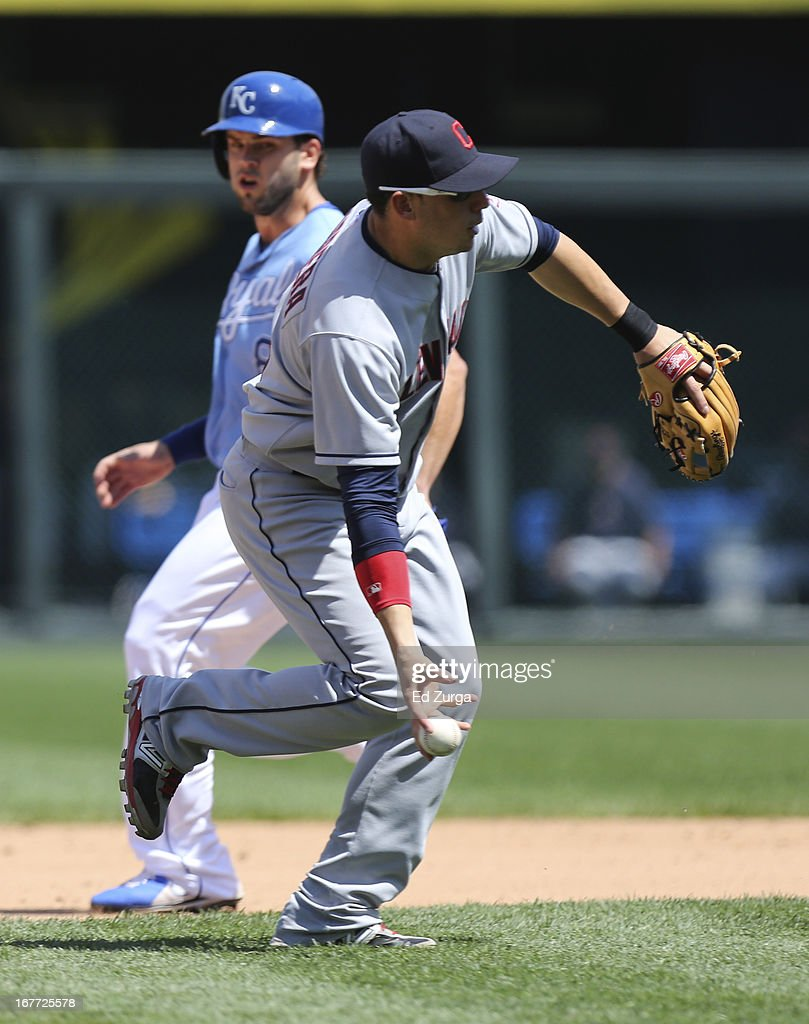 <a gi-track='captionPersonalityLinkClicked' href=/galleries/search?phrase=Asdrubal+Cabrera&family=editorial&specificpeople=834042 ng-click='$event.stopPropagation()'>Asdrubal Cabrera</a> #13 of the Cleveland Indians fields a ball hit by Jeff Francoeur of the Kansas City Royals as <a gi-track='captionPersonalityLinkClicked' href=/galleries/search?phrase=Mike+Moustakas&family=editorial&specificpeople=6780077 ng-click='$event.stopPropagation()'>Mike Moustakas</a> #8 advances to second in the the fourth inning during game one of a doubleheader at Kauffman Stadium on April 28, 2013 in Kansas City, Missouri.