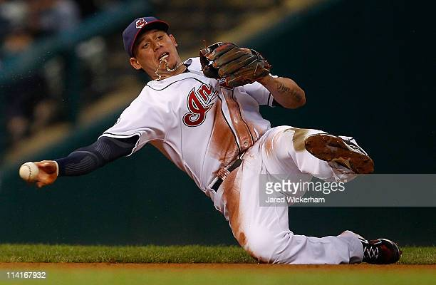 Asdrubal Cabrera of the Cleveland Indians fields a ground ball against the Seattle Mariners during the game on May 13 2011 at Progressive Field in...