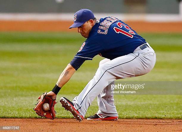 Asdrubal Cabrera of the Cleveland Indians fields a ground ball against the Boston Red Sox during the game at Fenway Park on June 12 2014 in Boston...