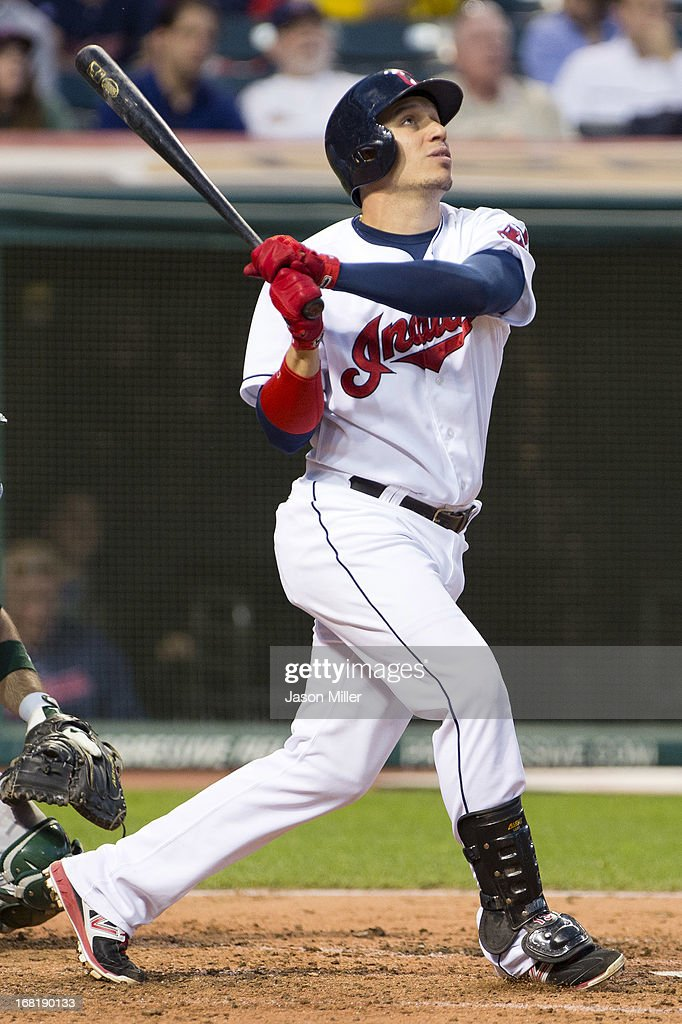 <a gi-track='captionPersonalityLinkClicked' href=/galleries/search?phrase=Asdrubal+Cabrera&family=editorial&specificpeople=834042 ng-click='$event.stopPropagation()'>Asdrubal Cabrera</a> #13 of the Cleveland Indians hits a solo home run during the fifth inning against the Oakland Athletics at Progressive Field on May 6, 2013 in Cleveland, Ohio.