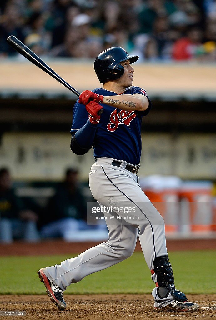 <a gi-track='captionPersonalityLinkClicked' href=/galleries/search?phrase=Asdrubal+Cabrera&family=editorial&specificpeople=834042 ng-click='$event.stopPropagation()'>Asdrubal Cabrera</a> #13 of the Cleveland Indians hits an RBI double scoring Michael Brantley #23 in the six inning against the Oakland Athletics at O.co Coliseum on August 17, 2013 in Oakland, California.