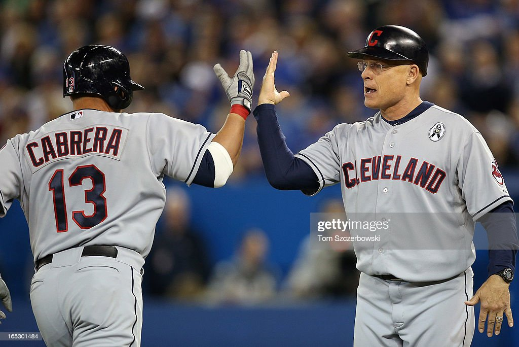 <a gi-track='captionPersonalityLinkClicked' href=/galleries/search?phrase=Asdrubal+Cabrera&family=editorial&specificpeople=834042 ng-click='$event.stopPropagation()'>Asdrubal Cabrera</a> #13 of the Cleveland Indians is congratulated by Brad Mills #2 after hitting a 2-run home run in the fifth inning during MLB game action on Opening Day against the Toronto Blue Jays on April 2, 2013 at Rogers Centre in Toronto, Ontario, Canada.