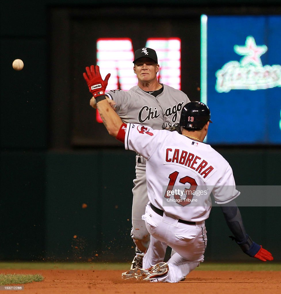 Asdrubal Cabrera of the Cleveland Indians is out at 2 base as Gordon Beckham of the Chicago White Sox fires to 1st to complete a 1-4-3 double play off the bat of Carlos Santana of the Cleveland Indians in the 4th inning at Progressive Field in Cleveland, Ohio on Monday, October 1, 2012.