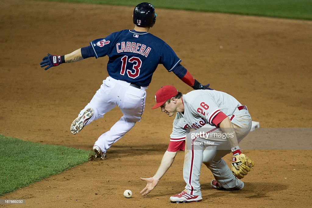 <a gi-track='captionPersonalityLinkClicked' href=/galleries/search?phrase=Asdrubal+Cabrera&family=editorial&specificpeople=834042 ng-click='$event.stopPropagation()'>Asdrubal Cabrera</a> #13 of the Cleveland Indians is safe at second as second baseman <a gi-track='captionPersonalityLinkClicked' href=/galleries/search?phrase=Chase+Utley&family=editorial&specificpeople=161391 ng-click='$event.stopPropagation()'>Chase Utley</a> #26 of the Philadelphia Phillies fields a ground ball off the bat of Carlos Santana #41 during the eighth inning at Progressive Field on May 1, 2013 in Cleveland, Ohio. The Indians defeated the Phillies 6-0.
