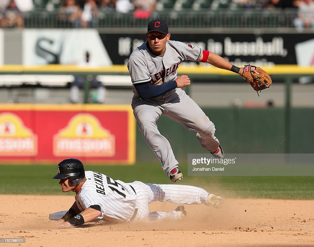 <a gi-track='captionPersonalityLinkClicked' href=/galleries/search?phrase=Asdrubal+Cabrera&family=editorial&specificpeople=834042 ng-click='$event.stopPropagation()'>Asdrubal Cabrera</a> #13 of the Cleveland Indians leaps over <a gi-track='captionPersonalityLinkClicked' href=/galleries/search?phrase=Gordon+Beckham&family=editorial&specificpeople=5411079 ng-click='$event.stopPropagation()'>Gordon Beckham</a> #15 of the Chicago White Sox to complete a double play at U.S. Cellular Field on September 25, 2012 in Chicago, Illinois. The Indians defeated the White Sox 4-3.