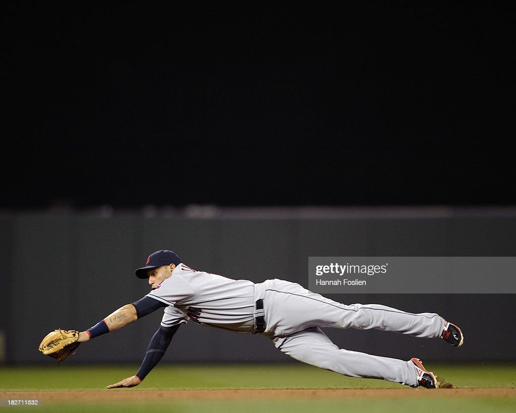 <a gi-track='captionPersonalityLinkClicked' href=/galleries/search?phrase=Asdrubal+Cabrera&family=editorial&specificpeople=834042 ng-click='$event.stopPropagation()'>Asdrubal Cabrera</a> #13 of the Cleveland Indians makes a play at shortstop during the game against the Minnesota Twins on September 26, 2013 at Target Field in Minneapolis, Minnesota. (Photo by Hannah Foslien/Getty Images) ~~~