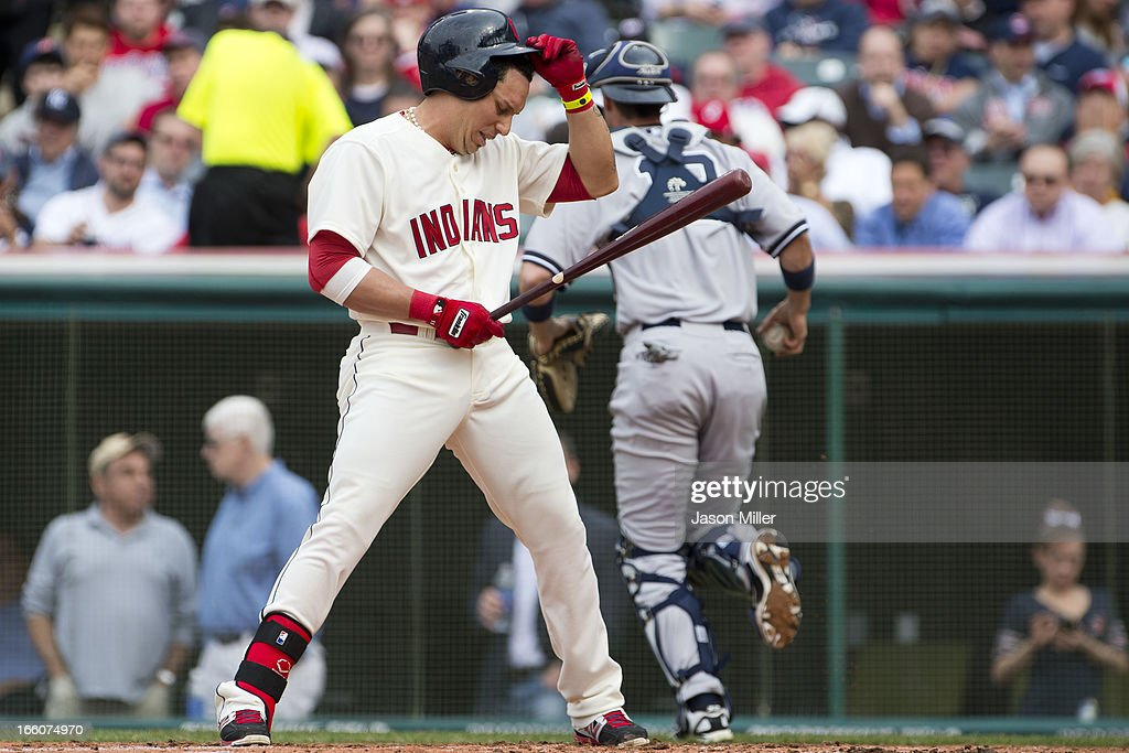 Asdrubal Cabrera #13 of the Cleveland Indians reacts after striking out looking to end the second inning against the New York Yankees on opening day at Progressive Field on April 8, 2013 in Cleveland, Ohio.