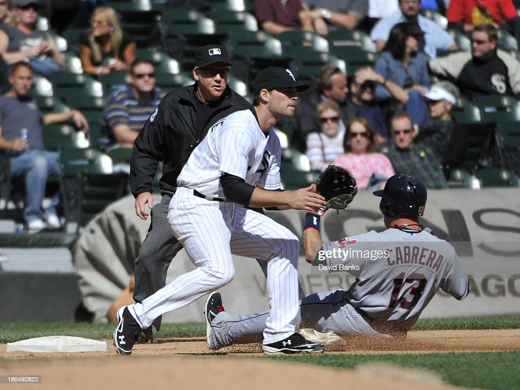 <a gi-track='captionPersonalityLinkClicked' href=/galleries/search?phrase=Asdrubal+Cabrera&family=editorial&specificpeople=834042 ng-click='$event.stopPropagation()'>Asdrubal Cabrera</a> #13 of the Cleveland Indians slides safely into third base as <a gi-track='captionPersonalityLinkClicked' href=/galleries/search?phrase=Conor+Gillaspie&family=editorial&specificpeople=5115369 ng-click='$event.stopPropagation()'>Conor Gillaspie</a> #12 of the Chicago White Sox takes the throw during the fourth inning on September 13, 2013 at U.S. Cellular Field in Chicago, Illinois.