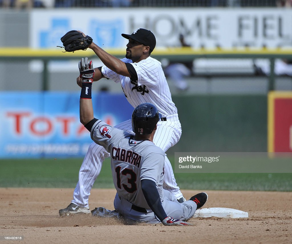 <a gi-track='captionPersonalityLinkClicked' href=/galleries/search?phrase=Asdrubal+Cabrera&family=editorial&specificpeople=834042 ng-click='$event.stopPropagation()'>Asdrubal Cabrera</a> #13 of the Cleveland Indians steals second base as Marcus Semien #5 of the Chicago White Sox takes the throw during the fourth inning on September 13, 2013 at U.S. Cellular Field in Chicago, Illinois.