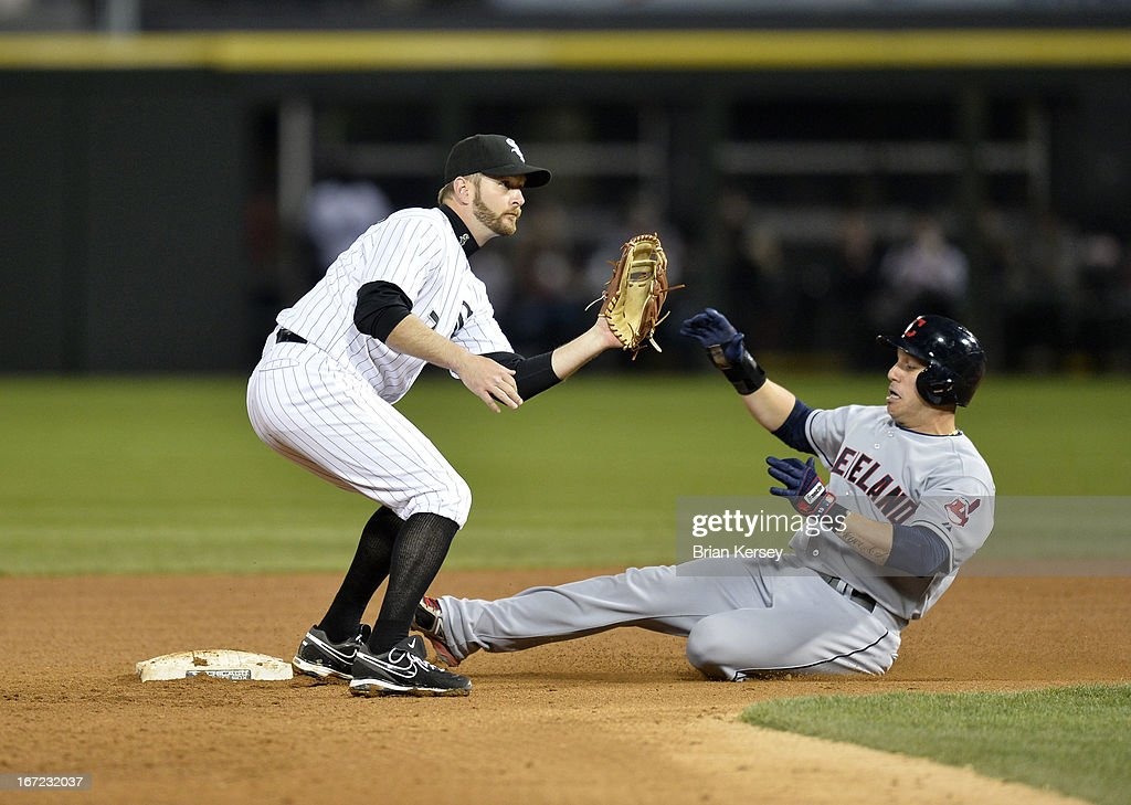 <a gi-track='captionPersonalityLinkClicked' href=/galleries/search?phrase=Asdrubal+Cabrera&family=editorial&specificpeople=834042 ng-click='$event.stopPropagation()'>Asdrubal Cabrera</a> #13 of the Cleveland Indians (R) steals second base as second baseman <a gi-track='captionPersonalityLinkClicked' href=/galleries/search?phrase=Jeff+Keppinger&family=editorial&specificpeople=835796 ng-click='$event.stopPropagation()'>Jeff Keppinger</a> #7 of the Chicago White Sox waits for the throw during the eighth inning on April 22, 2012 at U.S. Cellular Field in Chicago, Illinois.