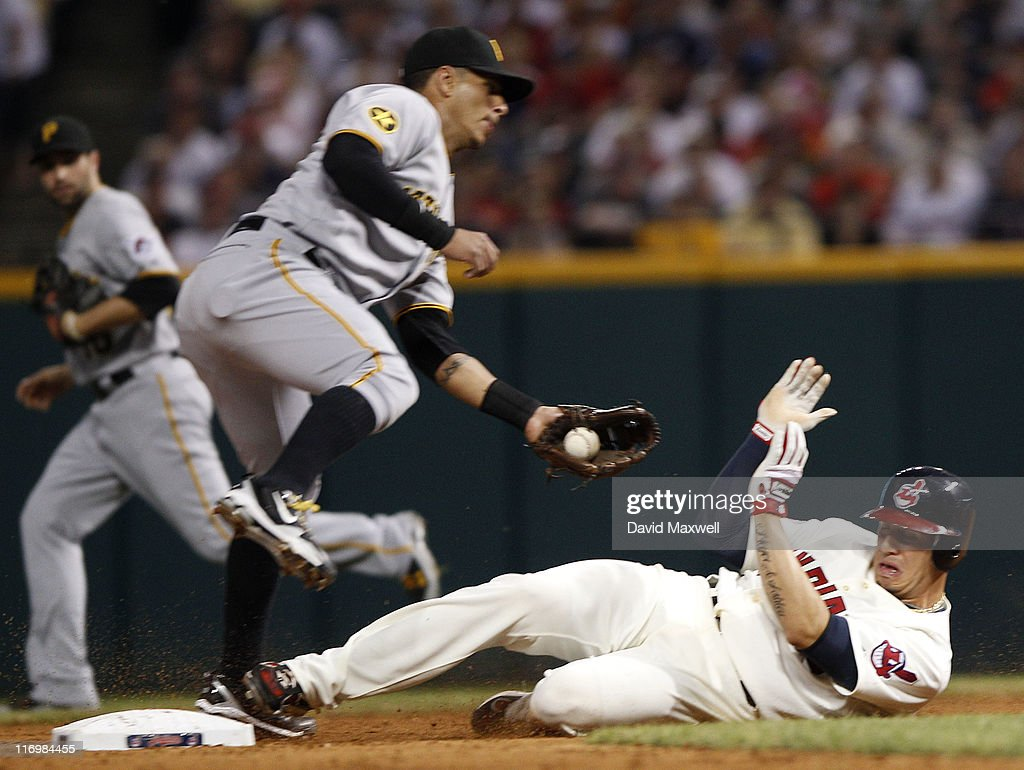 Asdrubal Cabrera of the Cleveland Indians steals second base underneath the tag attempt of Ronny Cedeno of the Pittsburgh Pirates during the seventh...