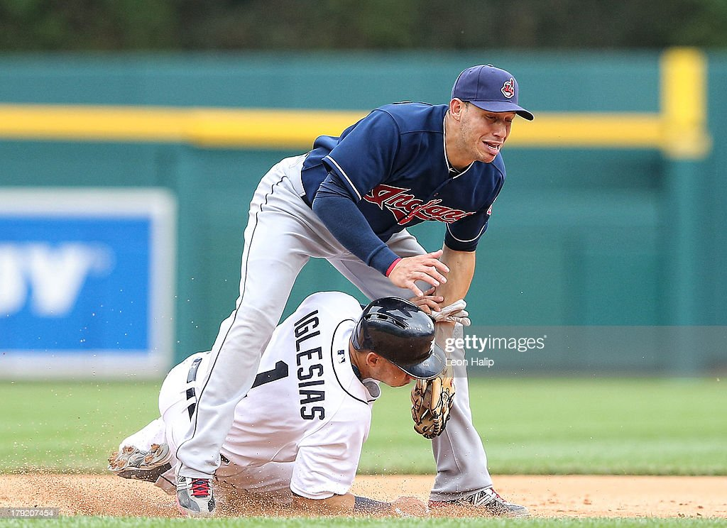 <a gi-track='captionPersonalityLinkClicked' href=/galleries/search?phrase=Asdrubal+Cabrera&family=editorial&specificpeople=834042 ng-click='$event.stopPropagation()'>Asdrubal Cabrera</a> #13 of the Cleveland Indians tags out Jose Iglesias #1 of the Detroit Tigers at second base during the eighth inning of the game at Comerica Park on September 1, 2013 in Detroit, Michigan. The Indians defeated the Tigers 4-0.
