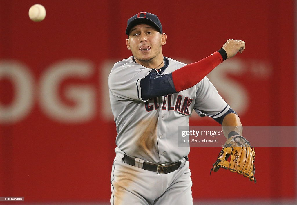 <a gi-track='captionPersonalityLinkClicked' href=/galleries/search?phrase=Asdrubal+Cabrera&family=editorial&specificpeople=834042 ng-click='$event.stopPropagation()'>Asdrubal Cabrera</a> #13 of the Cleveland Indians throws out the runner in the 5th inning during MLB game action against the Toronto Blue Jays on July 15, 2012 at Rogers Centre in Toronto, Ontario, Canada.