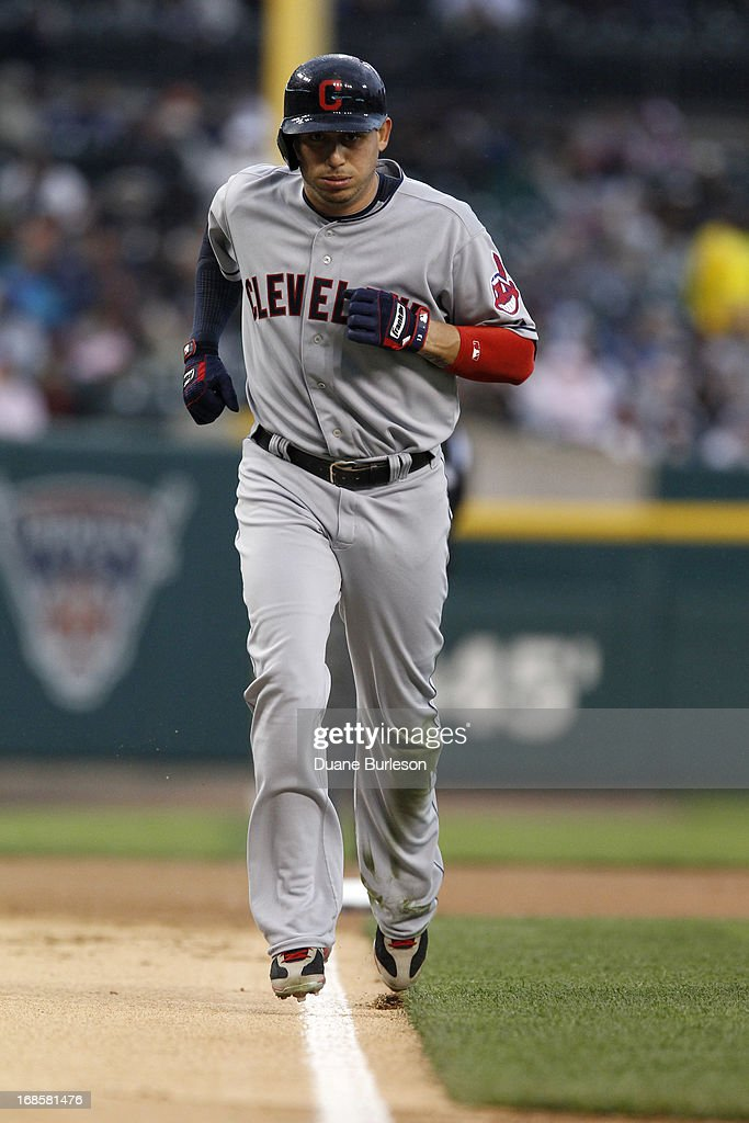 <a gi-track='captionPersonalityLinkClicked' href=/galleries/search?phrase=Asdrubal+Cabrera&family=editorial&specificpeople=834042 ng-click='$event.stopPropagation()'>Asdrubal Cabrera</a> #13 of the Cleveland Indians walks home in the first inning after Justin Verlander of the Detroit Tigers walked Jason Giambi with the bases loaded at Comerica Park on May 11, 2013 in Detroit, Michigan. The Indians defeated the Tigers 7-6.