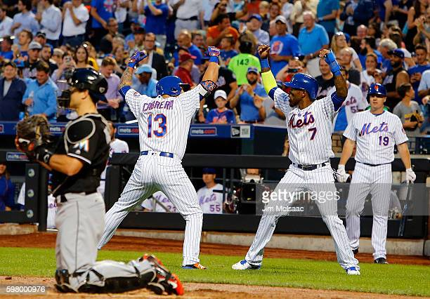 Asdrubal Cabrera of the New York Mets celebrates his first inning two run home run against the Miami Marlins with teammate Jose Reyes at Citi Field...
