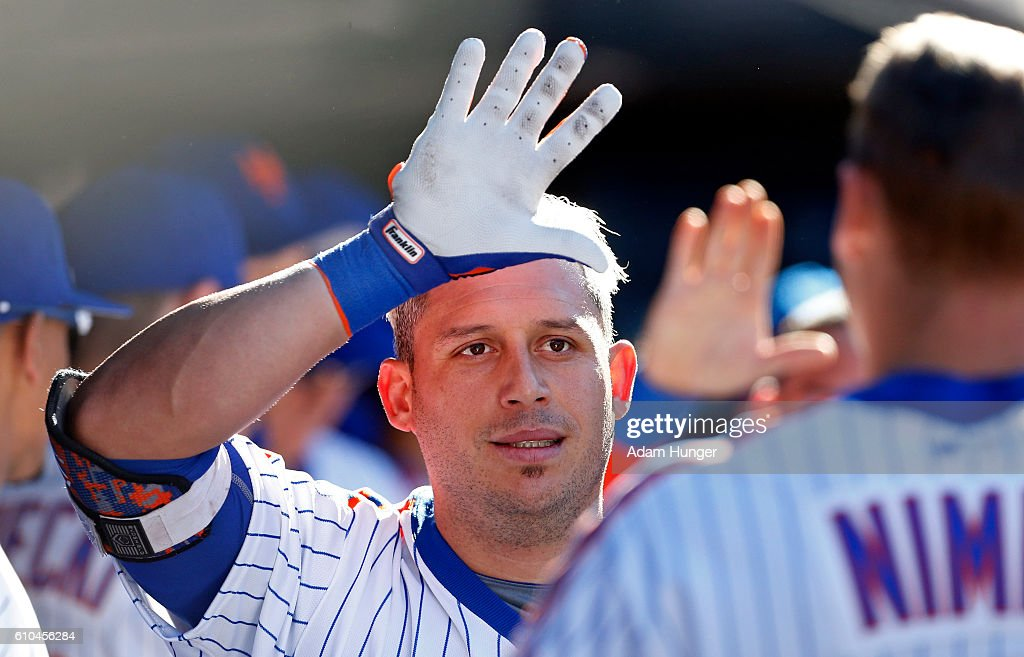 Asdrubal Cabrera #13 of the New York Mets celebrates hitting a grand slam with teammates during the seventh inning against the Philadelphia Phillies at Citi Field on September 25, 2016 in the Flushing neighborhood of the Queens borough of New York City.