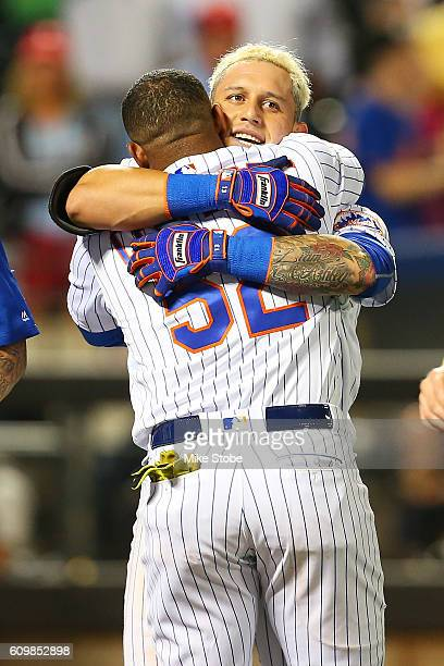 Asdrubal Cabrera of the New York Mets celebrates with Yoenis Cespedes after hitting a game winning walkoff three run home run in the bottom of the...