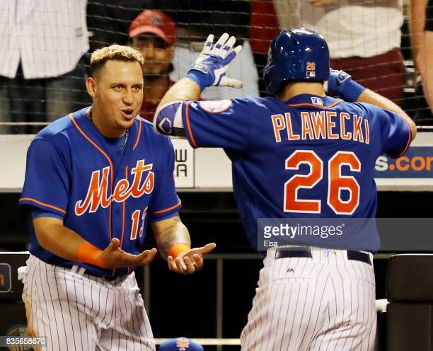 Asdrubal Cabrera of the New York Mets congratulates teammate Kevin Plawecki of the New York Mets after he hit a home run in the sixth inning against...