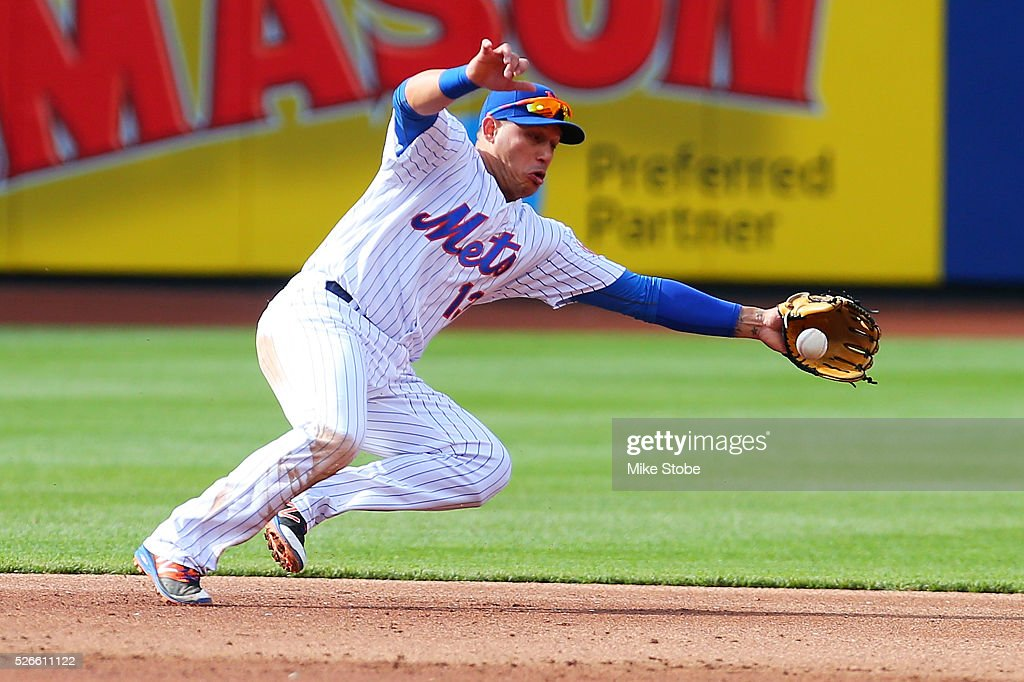 <a gi-track='captionPersonalityLinkClicked' href=/galleries/search?phrase=Asdrubal+Cabrera&family=editorial&specificpeople=834042 ng-click='$event.stopPropagation()'>Asdrubal Cabrera</a> #13 of the New York Mets fields an infield single off the bat of <a gi-track='captionPersonalityLinkClicked' href=/galleries/search?phrase=Angel+Pagan&family=editorial&specificpeople=666596 ng-click='$event.stopPropagation()'>Angel Pagan</a> #16 of the San Francisco Giants in the third inning at Citi Field on April 30, 2016 in the Flushing neighborhood of the Queens borough of New York City.